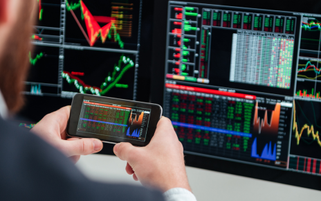 Trader reading charts and technical indicators