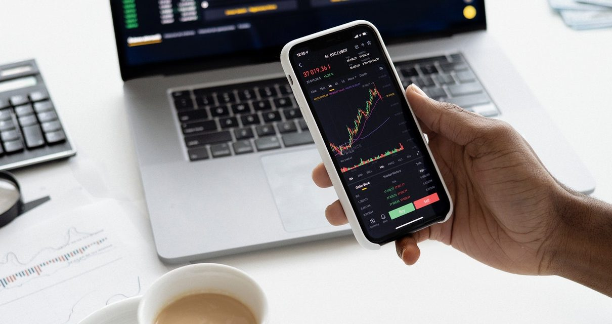 A trader watching charts in his mobile device