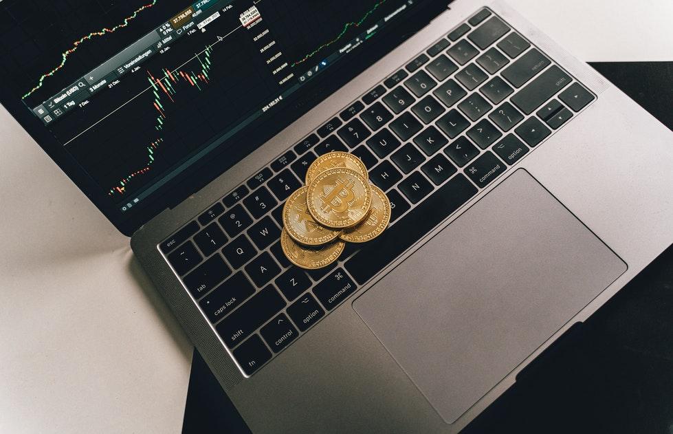 Bitcoins on a laptop