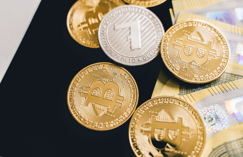 Cryptocurrency coins and money on a table
